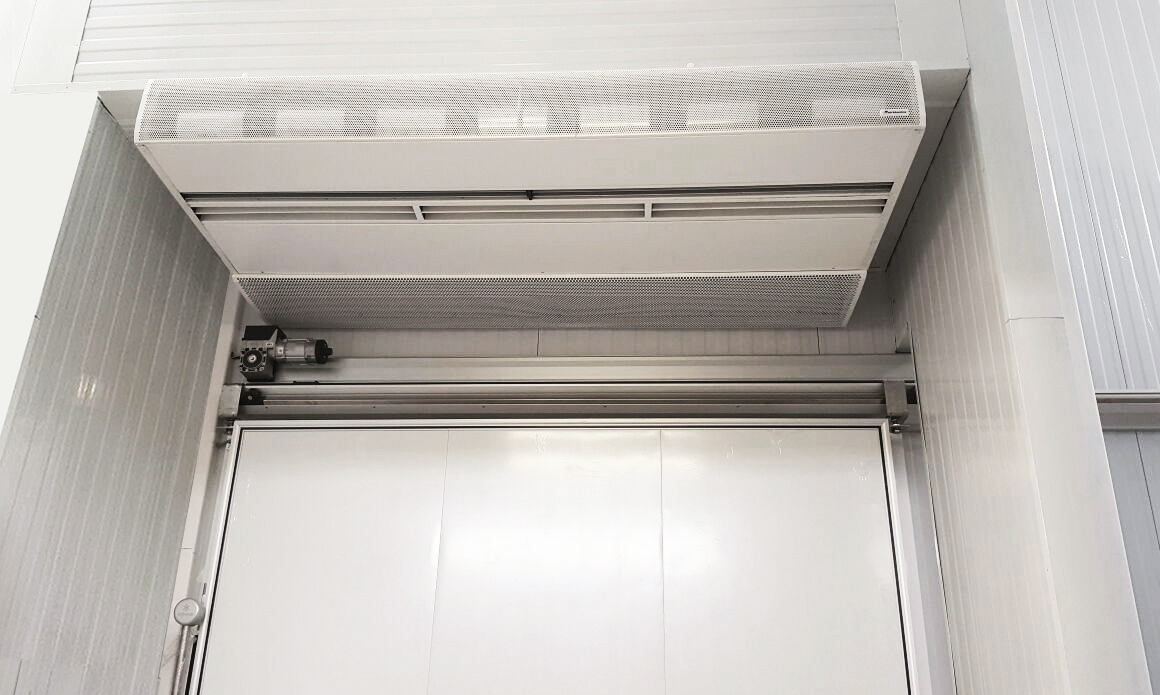 Installation of the Triojet system air curtain on a cold room door